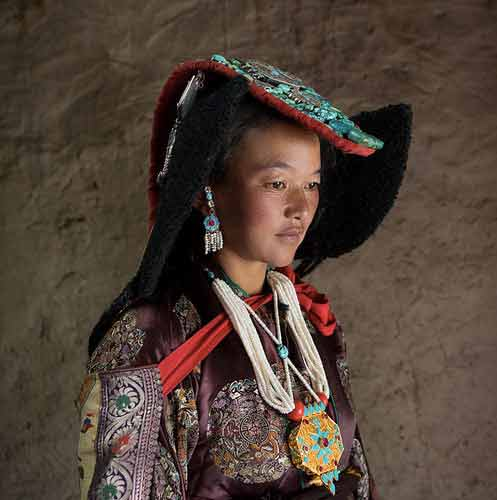 Young Ladakhi Woman in Ceremonial Dress by Peter Bos