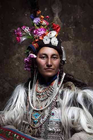Brogpa Woman in Ceremonial Dress, by Peter Bos. Photograph.