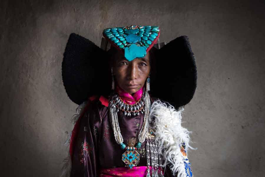 Ladakhi Woman wearing Perak (cobra-shaped ceremonial headdress)