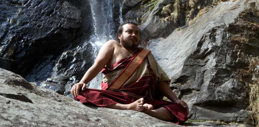 Bhutanese yogi in posture of Garuda
