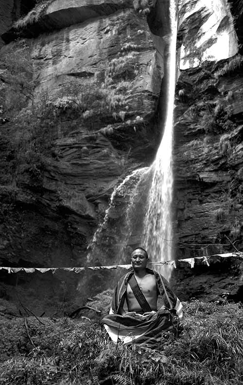 Bhutanese Yogi Meditating Beneath Waterfall